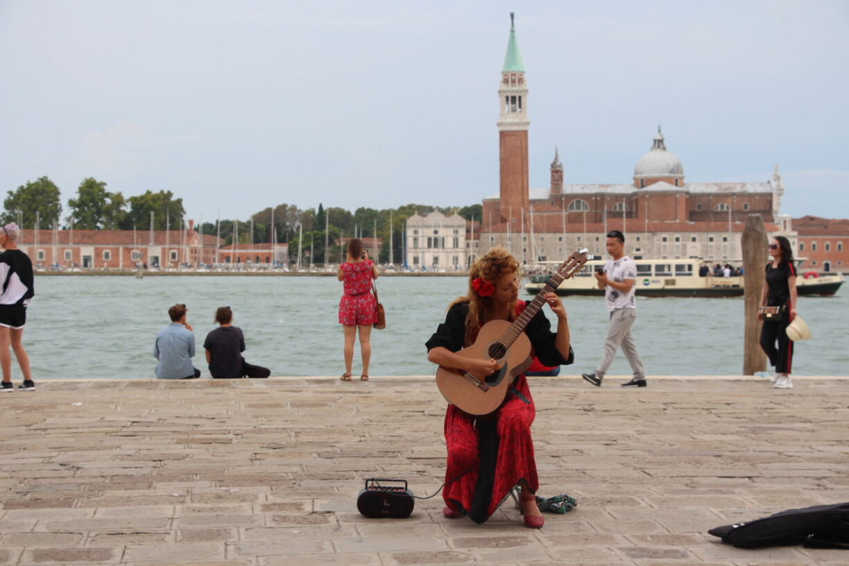 an artist performing in venice italy
